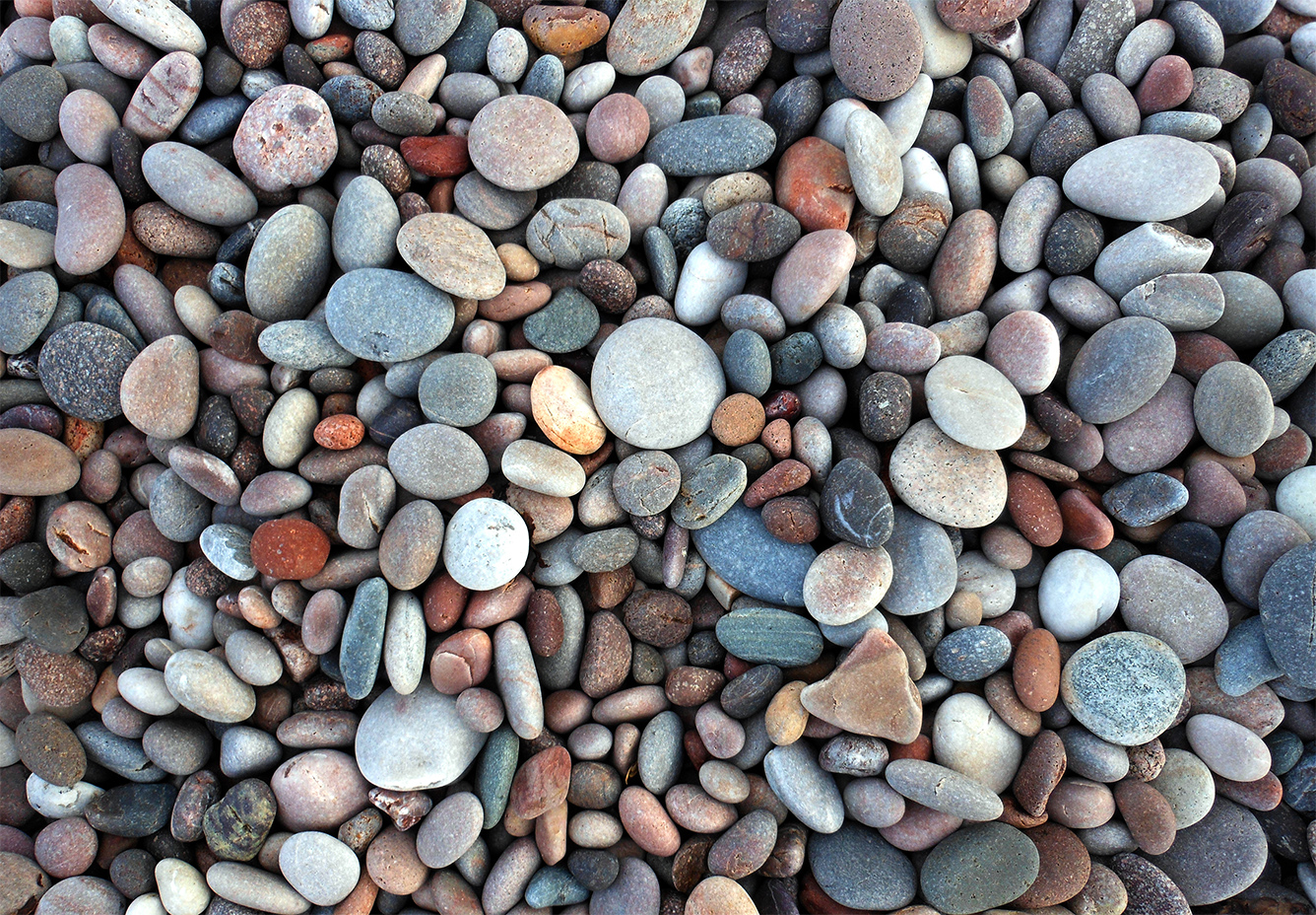 Low maintenance landscape designs in the lehigh valley for Different color rocks for landscaping
