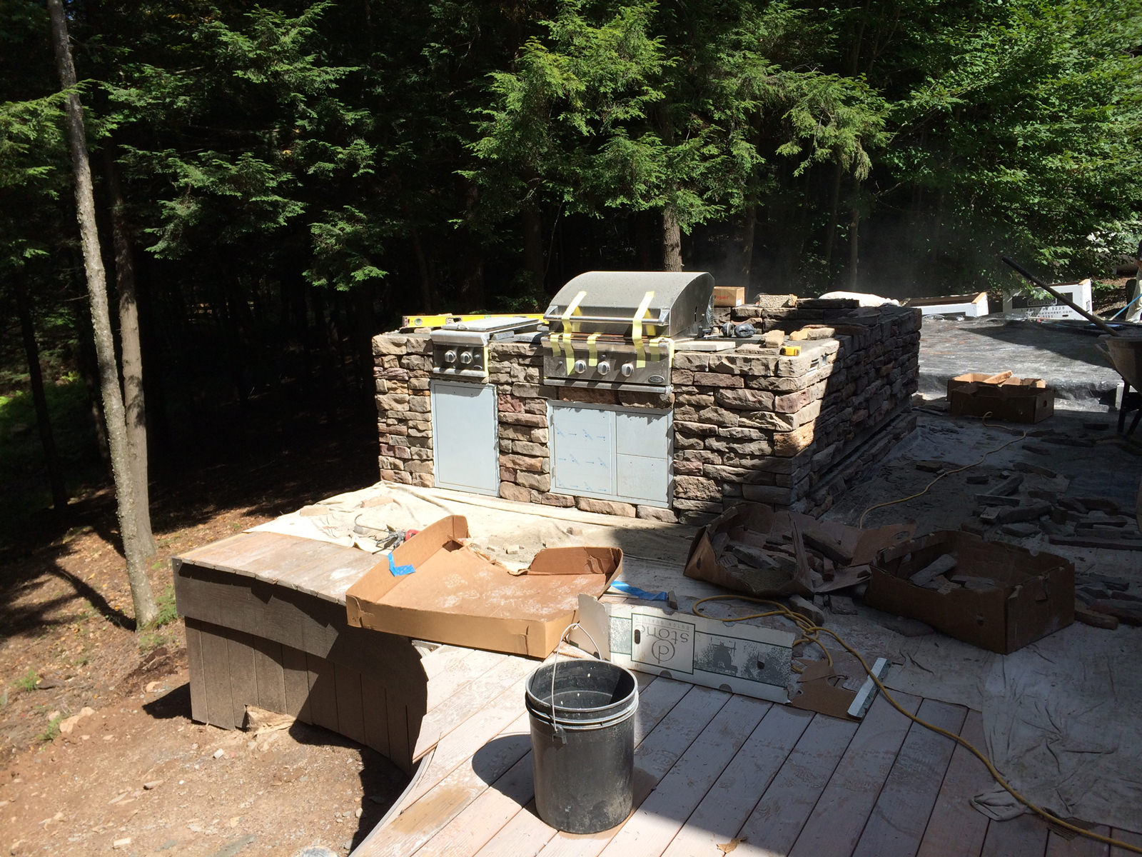 Once the outdoor kitchen appliances were in place and the stone veneer was installed, the space started to feel very inviting.