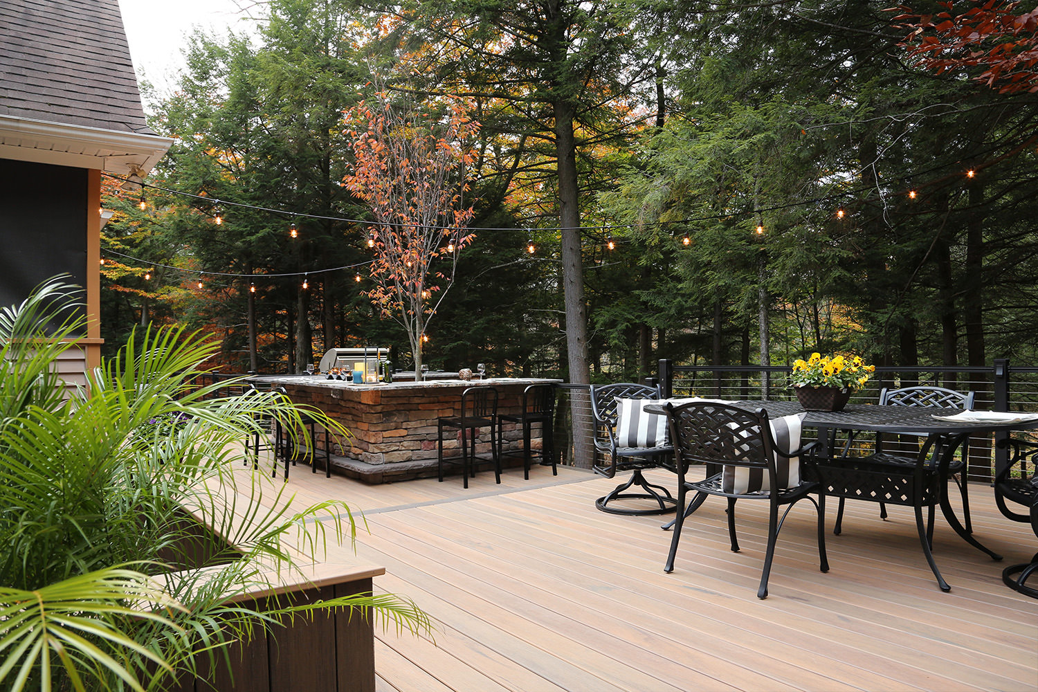 Different destination zones in this custom deck design make this space perfect for entertaining small and large groups alike!