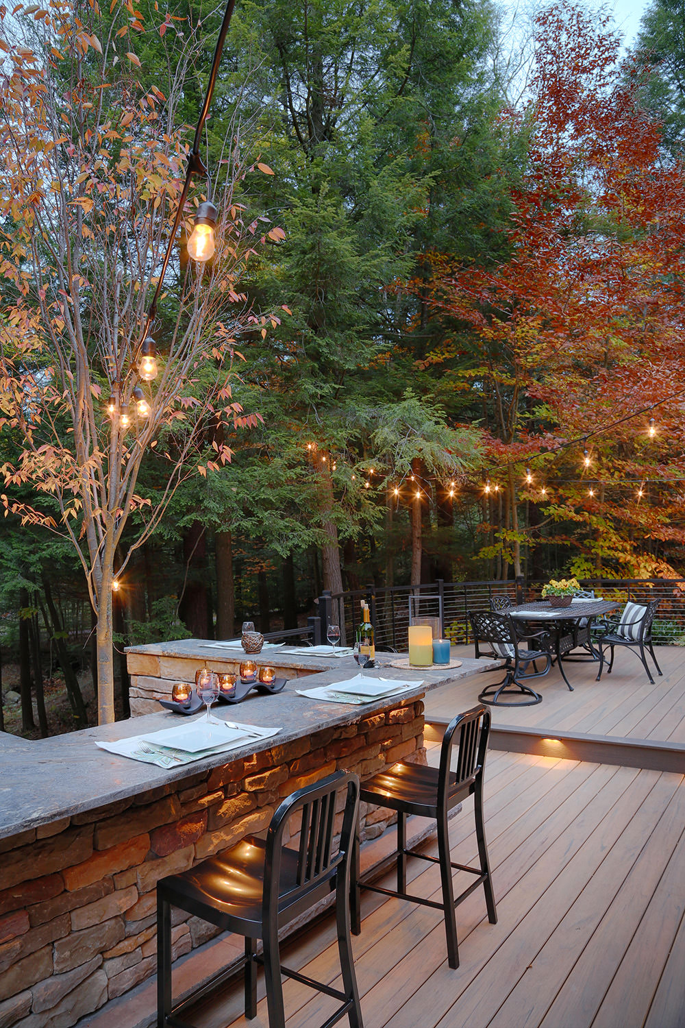 We were able to construct the new deck almost to the edge of the woods, designing the centrally located U-shaped stone bar as the focal point for entertainment.