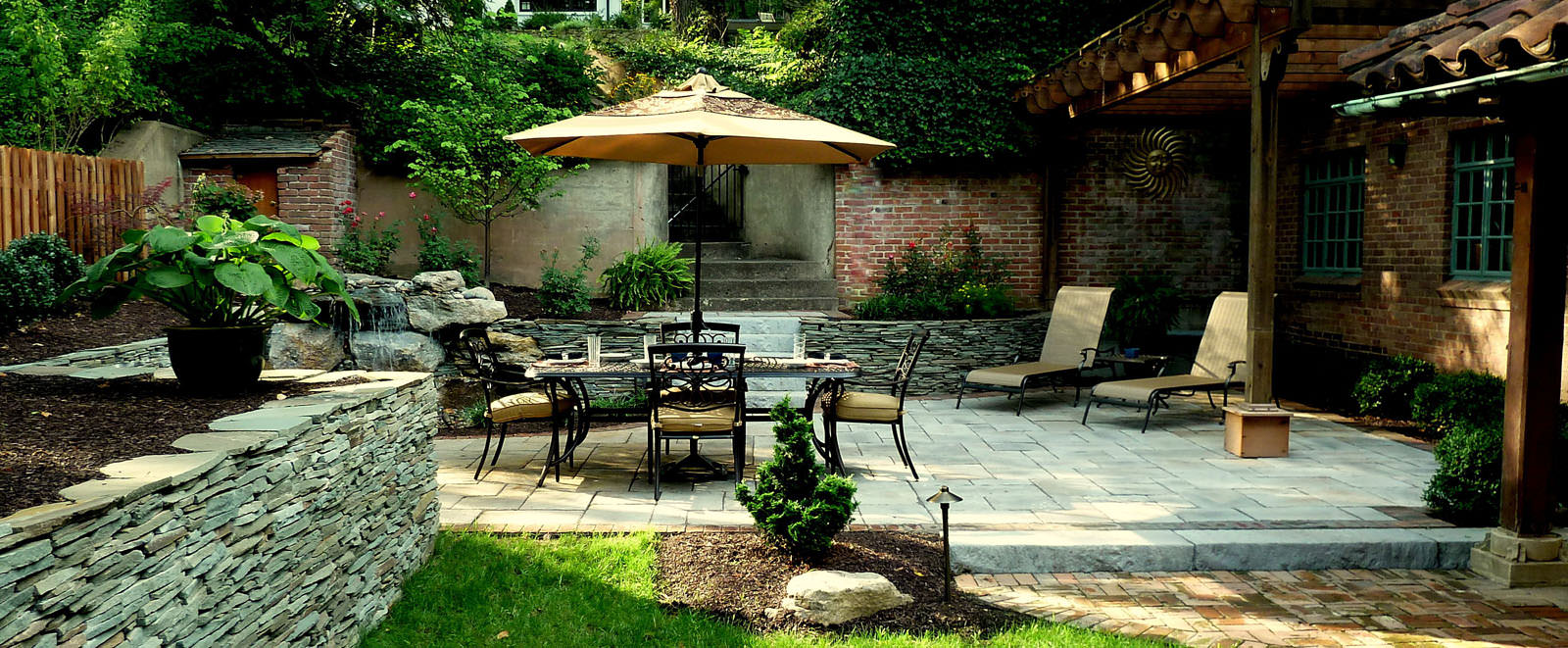 An outdoor living space should always feel as if it were original to the home.  Incorporating like materials of the home into the outdoor living space is a great way tie everything together.