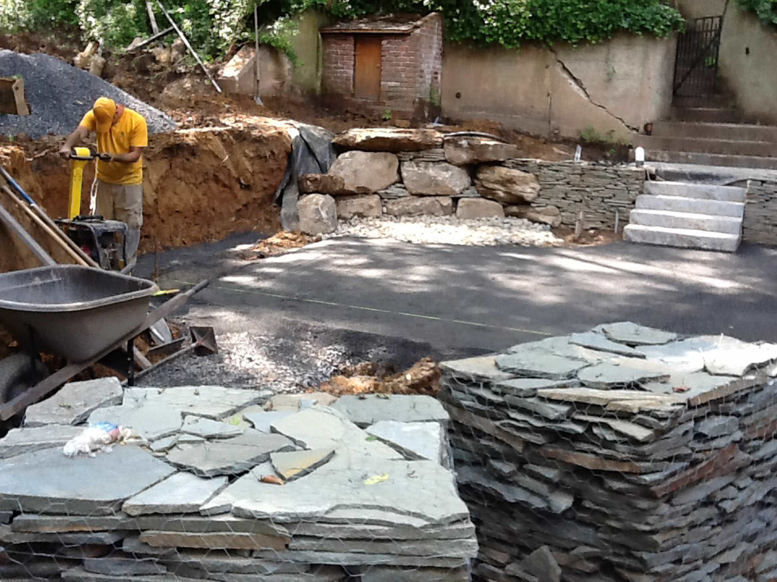 Once the space was leveled with precision, we were able to add the boulder for the water feature and prepare to start laying the flagstone patio!