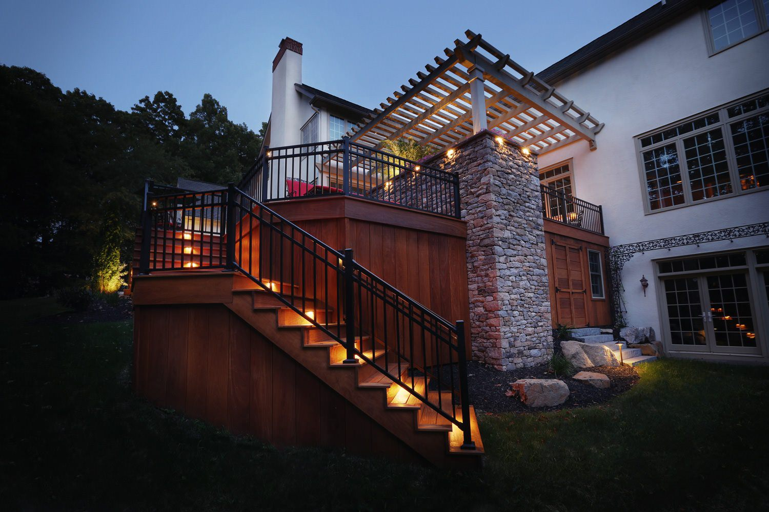 The combination of stone, wood, metal and warm LED lighting makes this space come alive with timeless beauty.