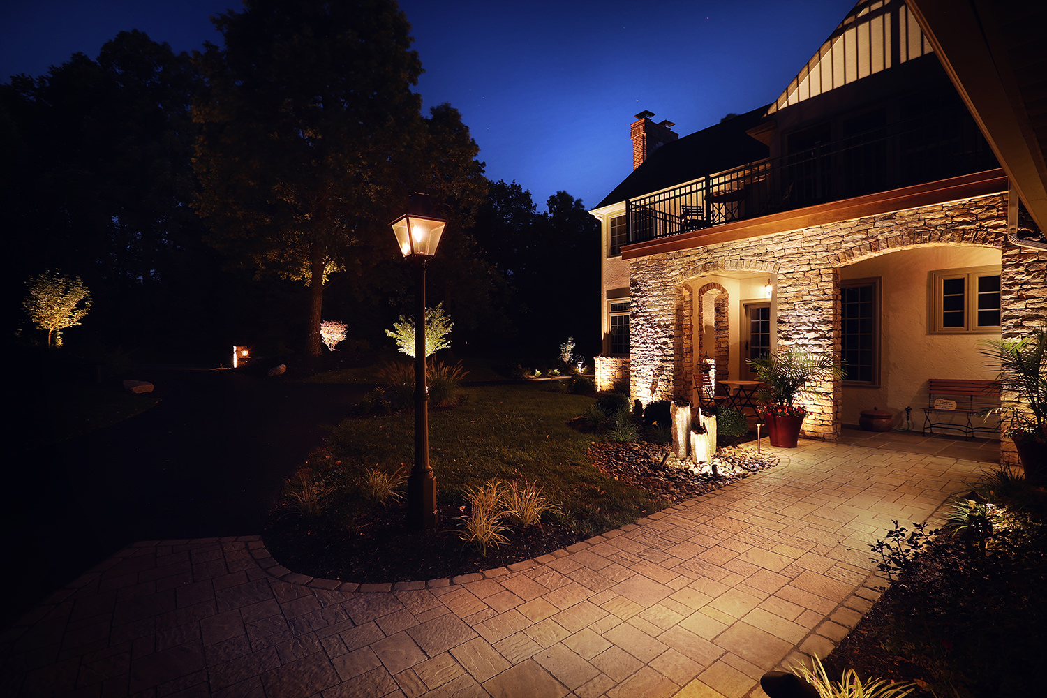 Greeted by a handcrafted gas lantern at the front of the walkway is our first glimpse into the detailed attention given to this landscape design.