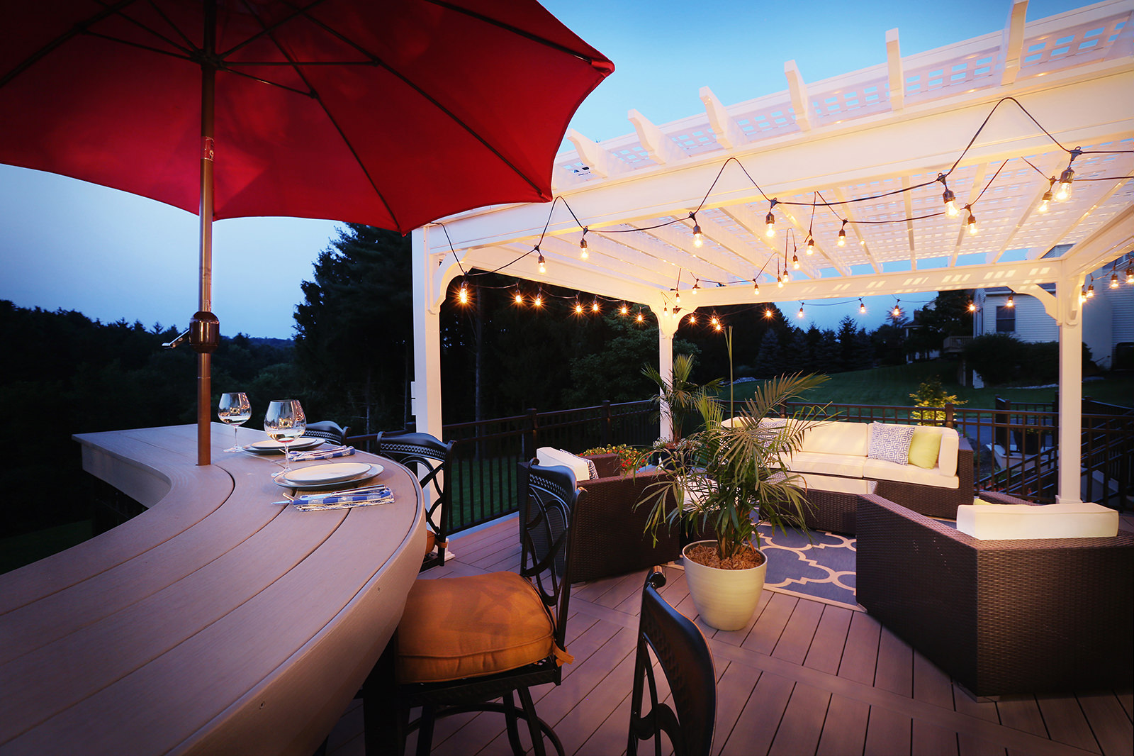 The homeowners requested destination areas within this outdoor living space.  Here, you can see the lounge and custom bar area, perfectly complimenting each other but performing their own function.