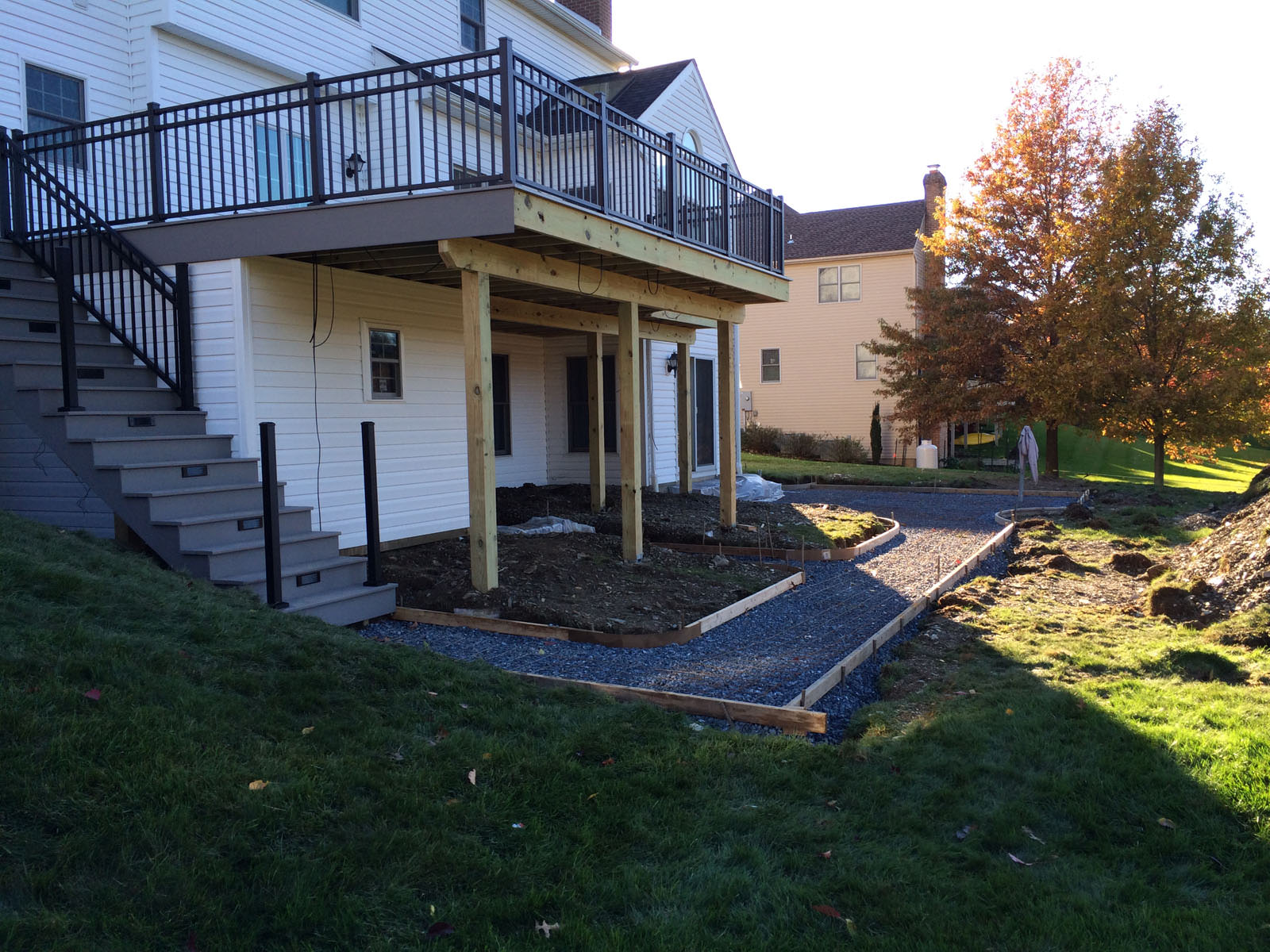 With the low maintenance deck almost complete, we were ready to have the stamped concrete installed!