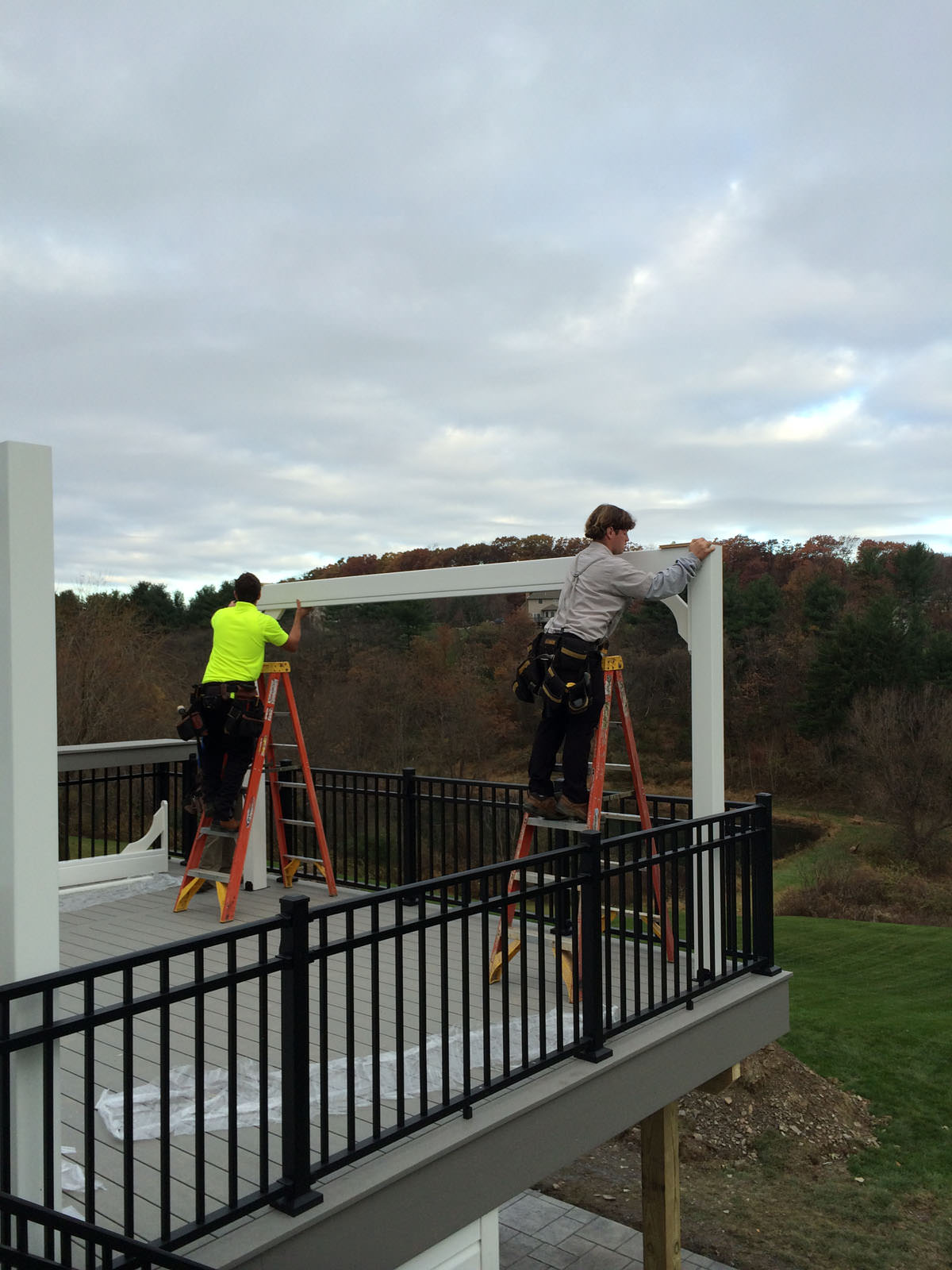 While the patio was being poured below, we were able to get started on the custom pergola on the deck.