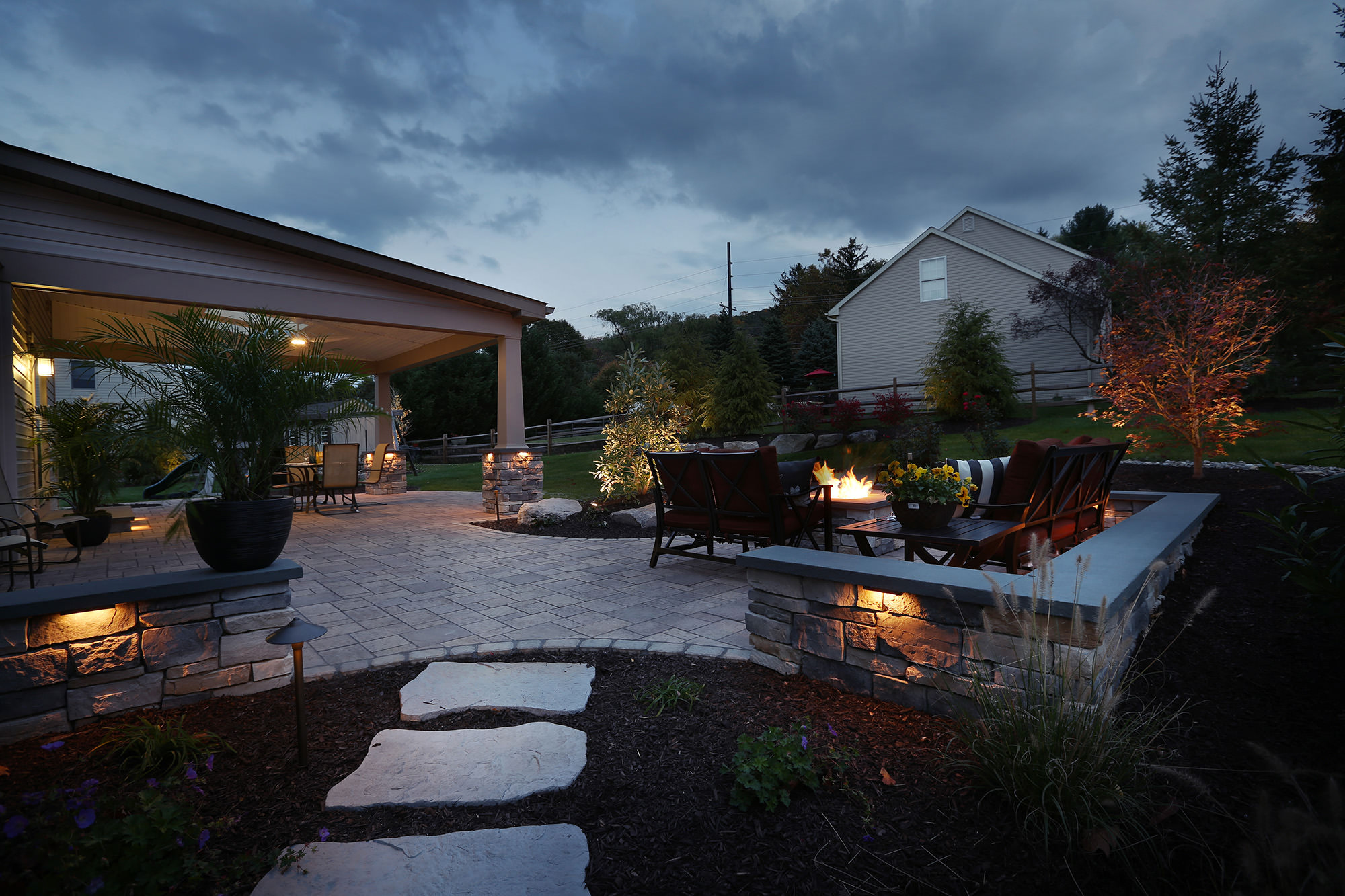 This stone wall doubles as wrap around seating for the fire pit.