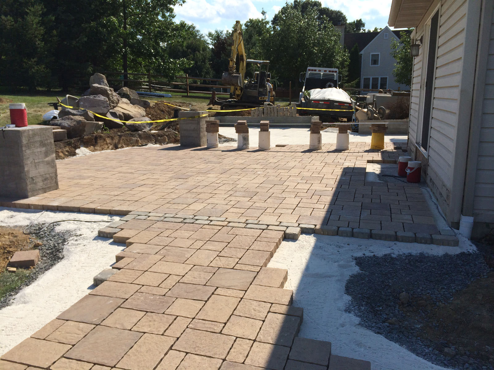 When we started to install the low maintenance paver patio, the homeowners were ecstatic over the gained square footage!