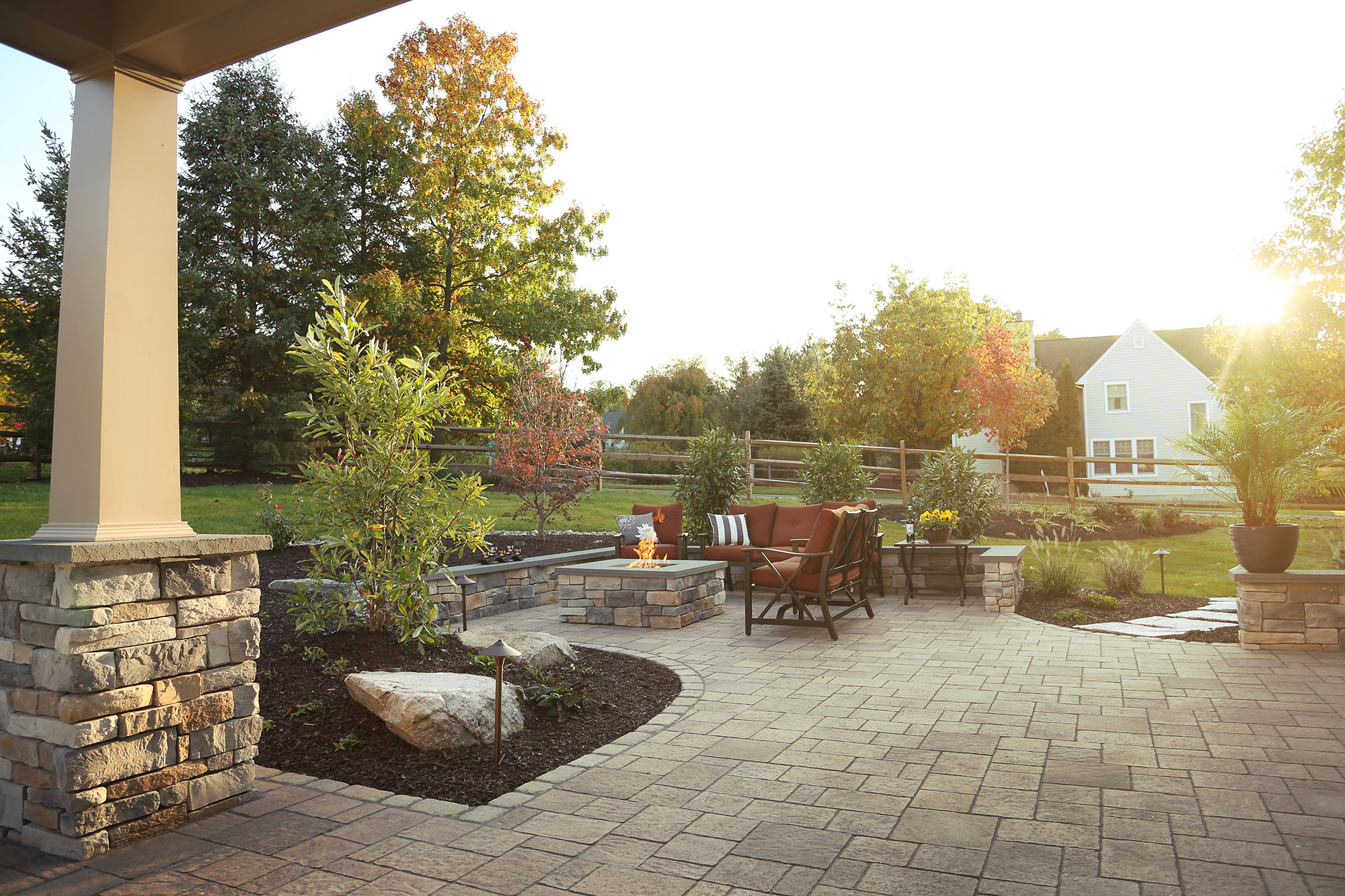 Including a natural gas fire pit into the patio provides a warm destination for the whole family to gather around and make memories.