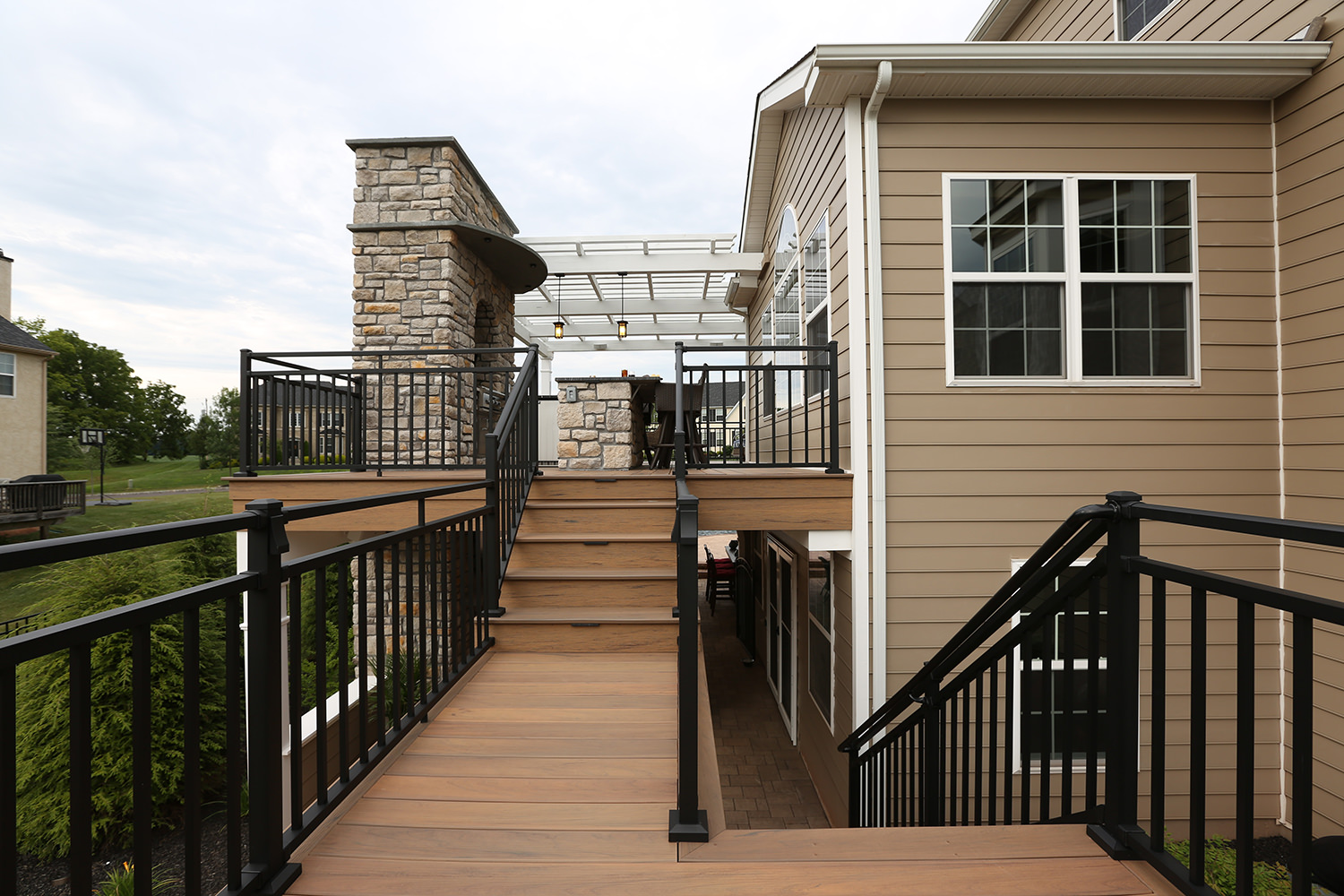 This low maintenance switchback staircase effortlessly connects the first and second floor living spaces while not obstructing any surrounding views!