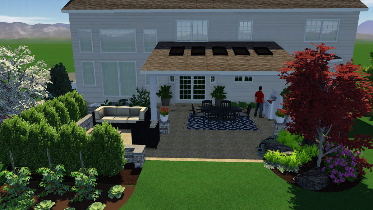 """Creating """"zones"""" in this master plan allowed for a designated cooking/dining area, as well as a lounge space complete with fire table!"""