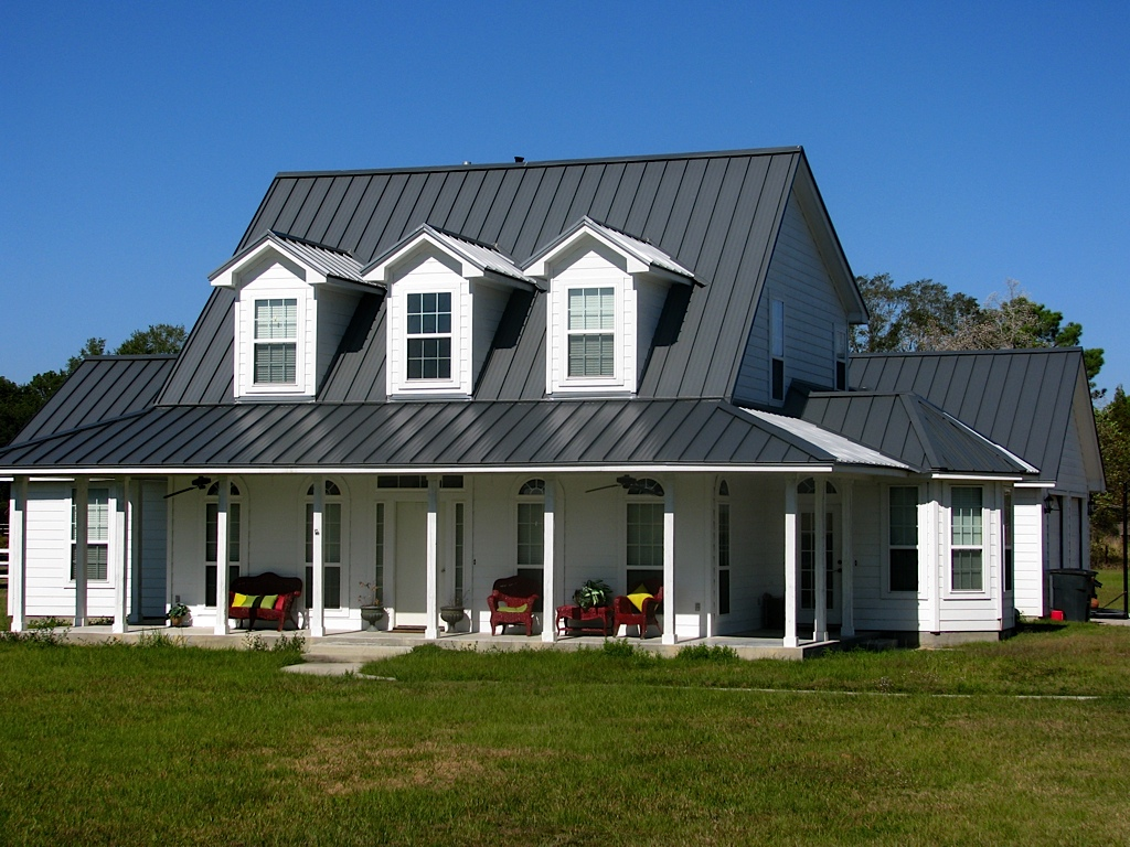 Material spotlight standing seam metal roofing for Homes with metal roofs photos