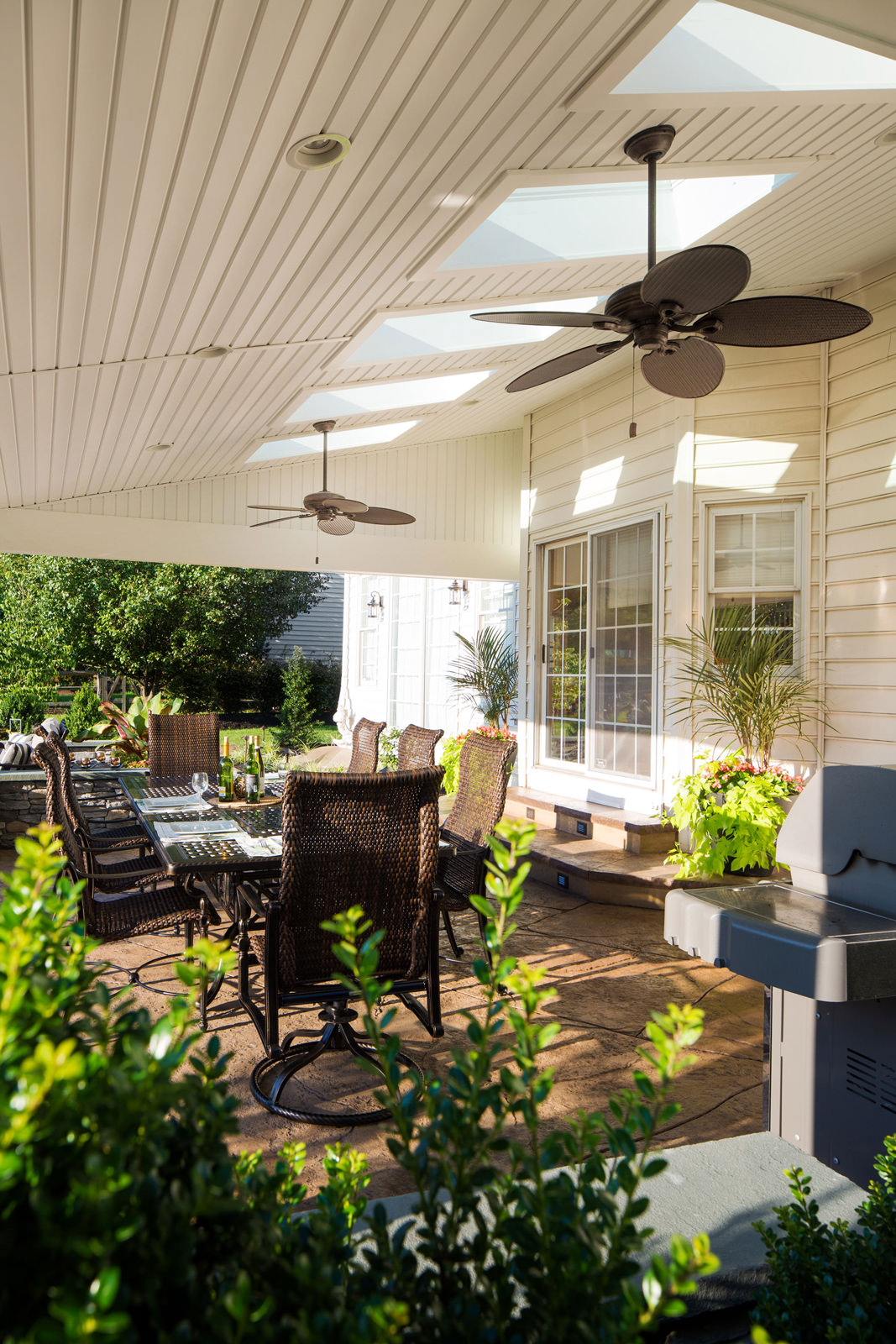 Incorporating skylights into our roof systems is a great way to allow natural light back into the home, and the ceiling fans add a nice breeze to the space at the same time.