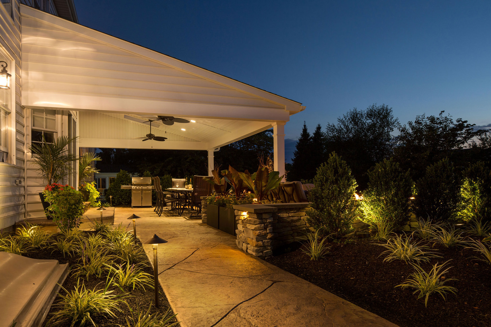 Warm LED landscape lighting is a beautiful way not only to highlight your garden, but to make sure you can see where you're walking at night!