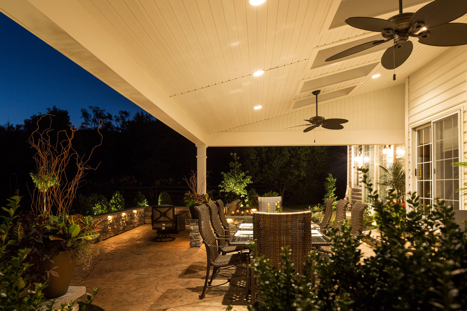 The combination of stone, metal and perfectly placed lighting truly invites all friends and family outside to enjoy.