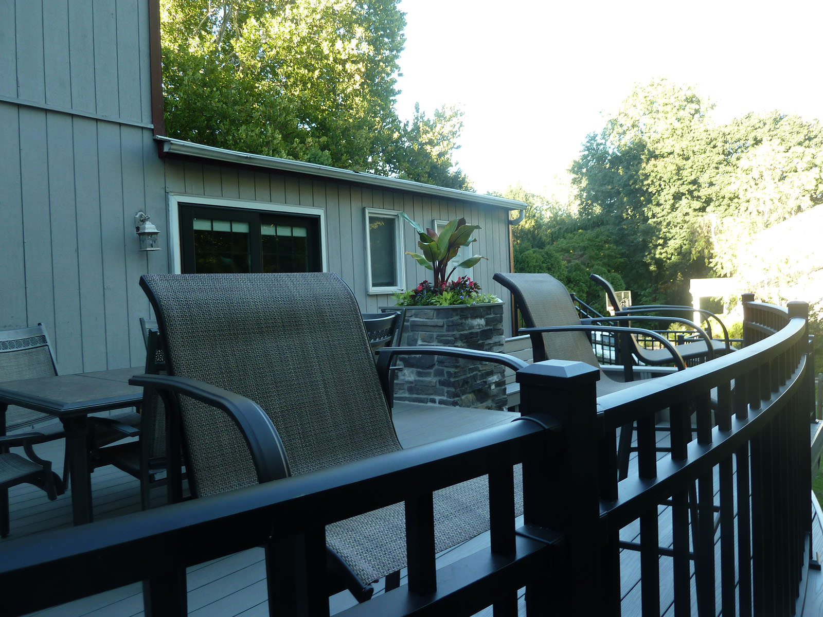 We designed and installed a custom curve to this deck to give the space much appreciated visual interest.