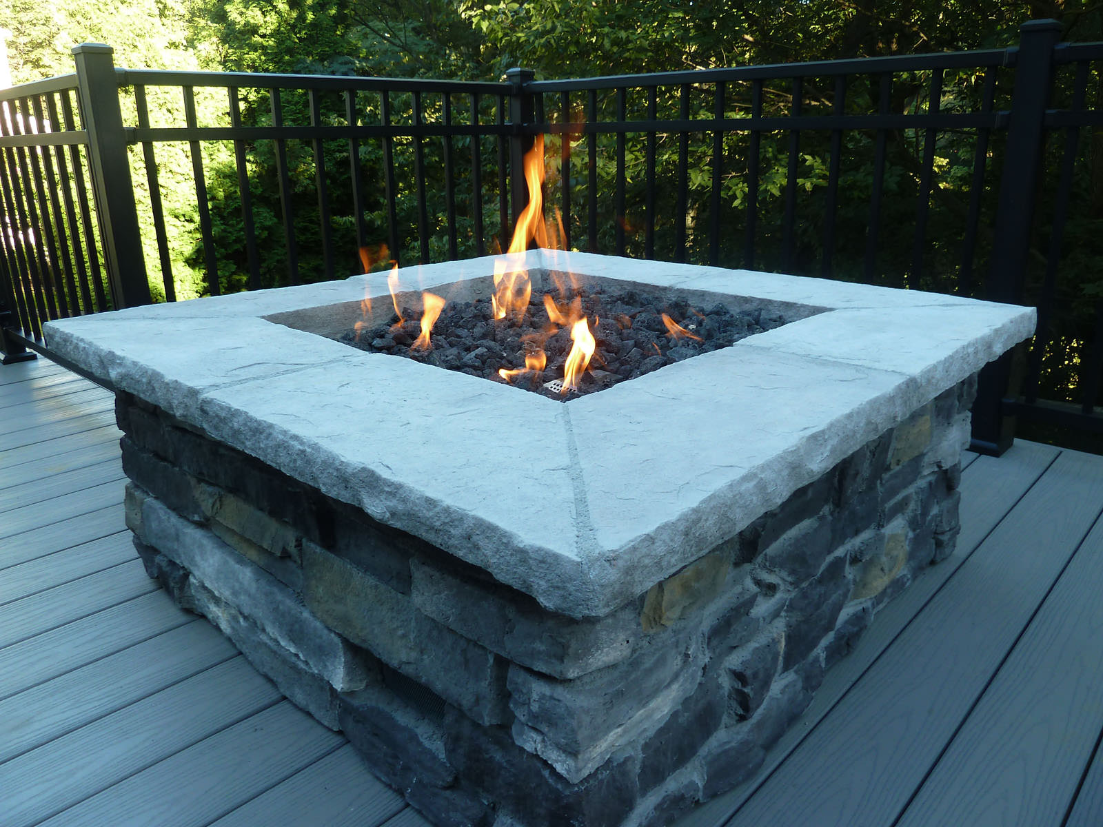 This gas firepit creates the perfect place to kick back and relax after a long day.