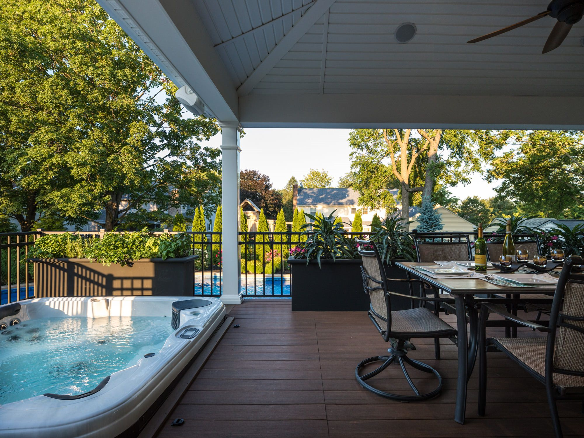 This sunken hot tub can be enjoyed 365 days a year due to its close proximity to the home and overhead roof protection.