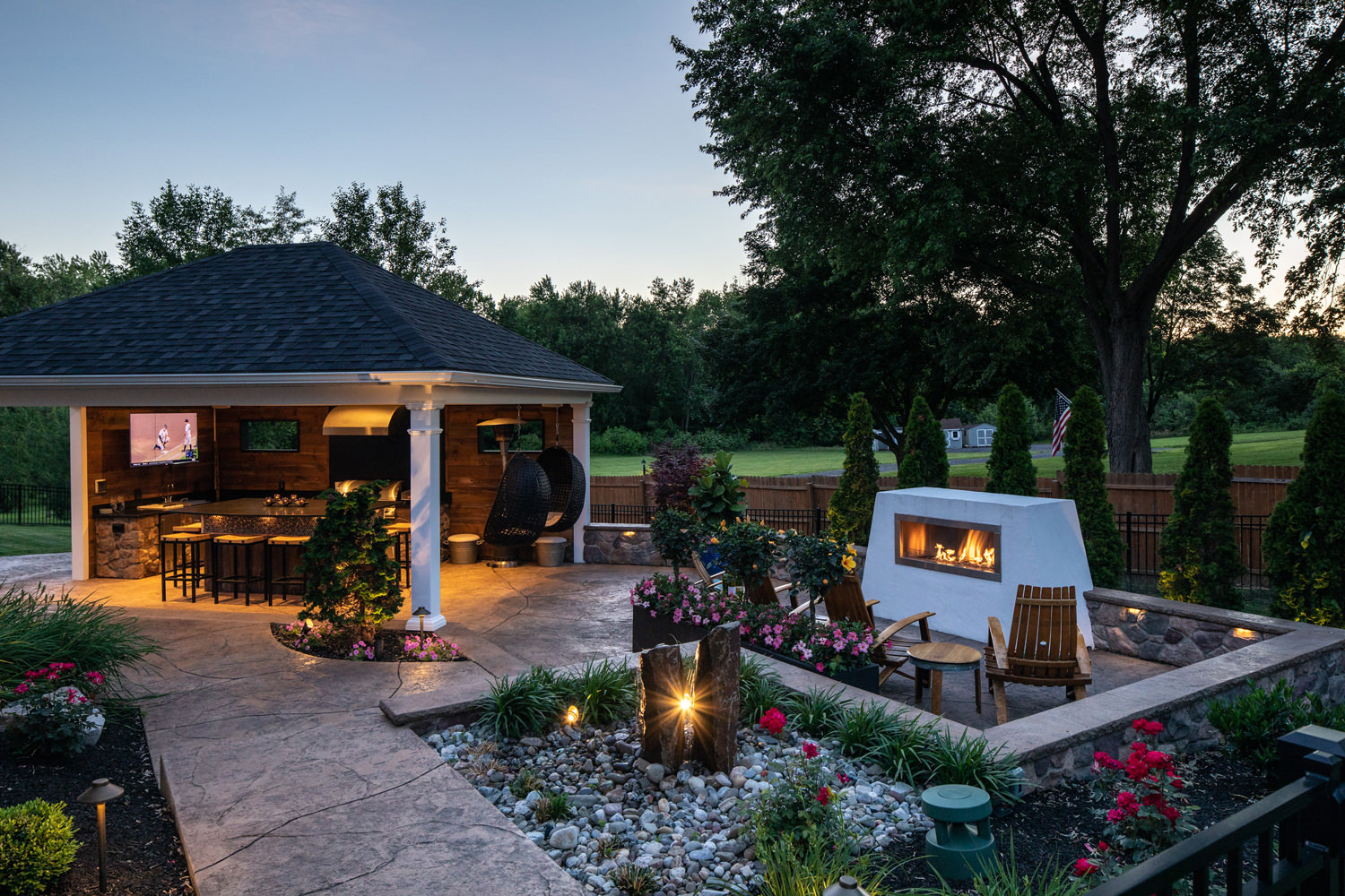 This photo captures the perfect balance between structure and landscape supporting and complementing each other to create a lovely and harmonious outdoor living space.