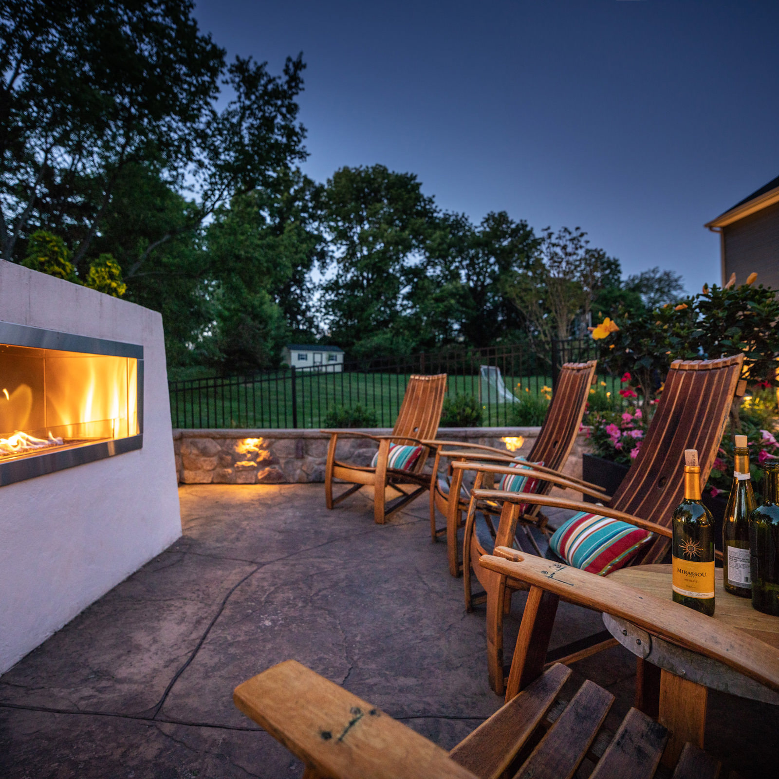 Chilly evenings have never felt so cozy and relaxing! This custom fireplace is a favorite backyard destination for this Royersford family.