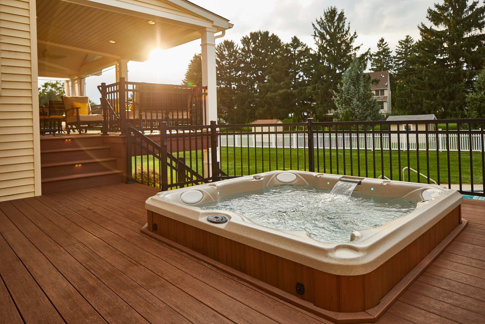 Sinking the hot tub in the deck eliminates the bulk of the feature and keeps the design clean and open!