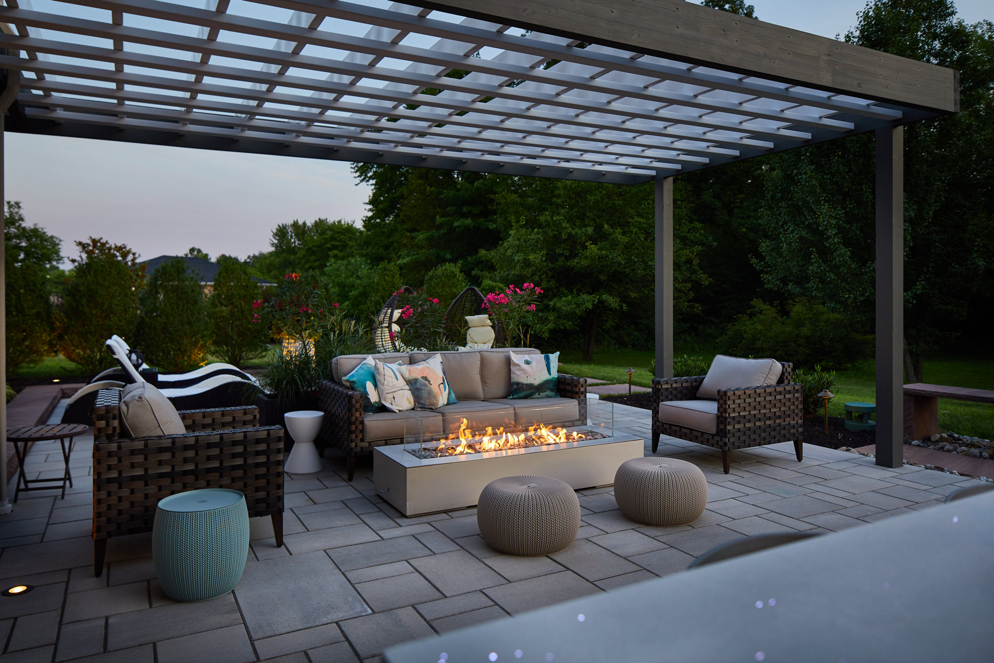 The lower patio lounge area is so beautiful and relaxing, imagine warming up by the fire listening to the nearby custom water feature…