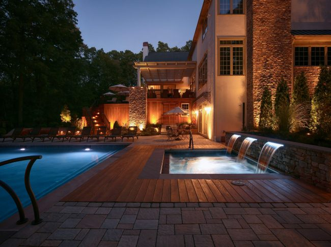 Well placed landscape lighting can help avoid dangerous trips, falls, or other accidents that could occur in a dark backyard.